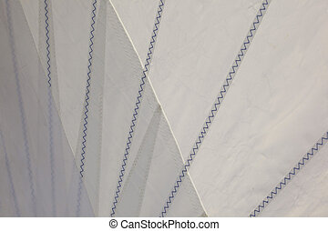 Sails - A detail of a sail Canvas sown together with blue...