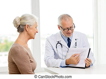 smiling senior woman and doctor meeting - medicine, age,...