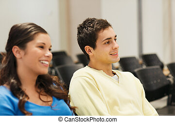 group of smiling students in lecture hall - education, high...
