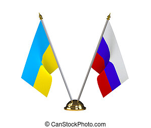 Ukraine and Russia table flags on a golden pedestal isolated...