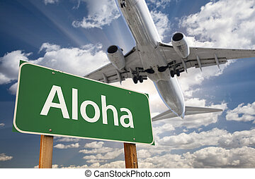 Aloha Green Road Sign and Airplane Above with Dramatic Blue...