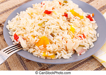 Cooked rice - Basmati rie cooked with colorful peppers on...