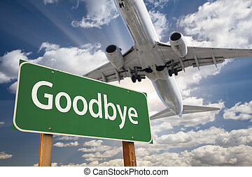 Goodbye Green Road Sign and Airplane Above with Dramatic...