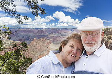 Happy Senior Couple Posing on Edge of The Grand Canyon