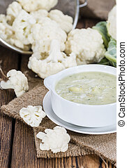 Cauliflower Soup - Portion of Cauliflower Soup on rustic...