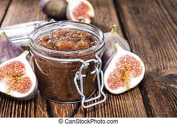 Fig Marmalade in a glass detailed close-up shot