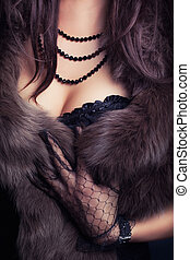woman wearing corset and fur in retro style