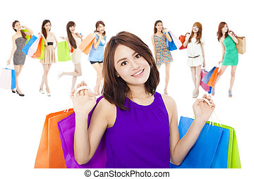 asian shopping women group holding color bags. isolated on...