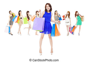 happy asian shopping women holding color bags. isolated on...