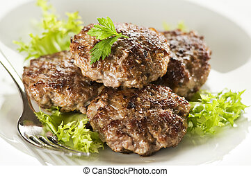 Meat - Fresh meat balls with salad close up shoot