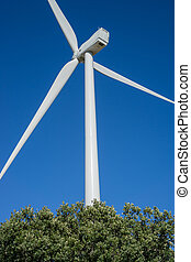 Wind turbines rear view in the countryside, blue sky - Rear...