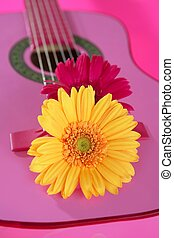 Hippie flower yellow pink gerbera on guitar - Hippie flower...