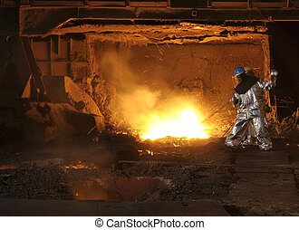 Factory worker at blast furnace - Factory worker working at...