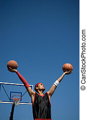 Confident Basketball Player - A young basketball player...