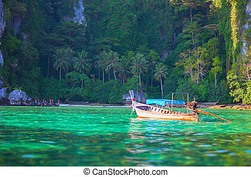 Tropical landscape, traditional long tail boat, Thailand Phi-Phi
