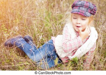 Portrait of a cheerful little girl on nature