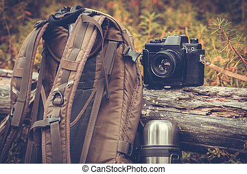 Lifestyle hiking camping equipment retro photo camera...