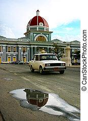 Cienfuegos city hall cuba with vintage car
