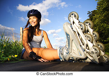 Woman on inline skates - Woman on rollerblades taking a rest...