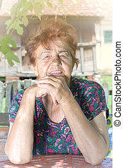 Femal portrait - Old and positive old female looking at the...
