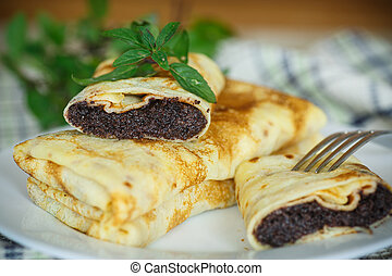 sweet pancakes with poppy seeds - traditional sweet pancakes...