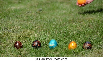 hand throw colorful eggs - Hand throw colorful eggs on grass...