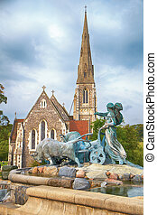 The Gefion Fountain in front of the St Albans Church in...