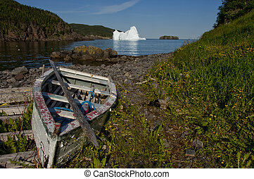 Iceberg in the Bay - An old discarded rowboat and its muted...