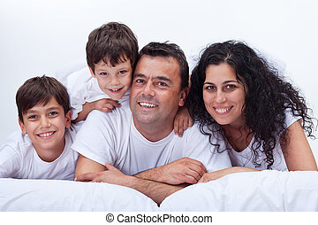 Happy family with kids - portrait in bed - Happy family with...