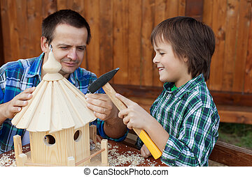 Father and son building a bird feeder together - preparing...