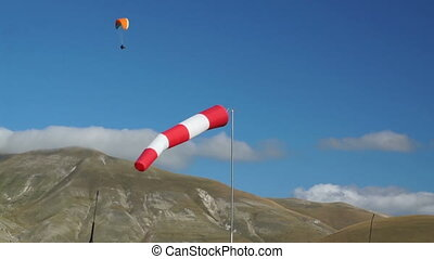In mountains of Italy wind sleeve and paragliding - In the...