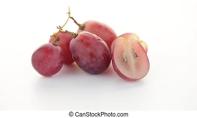 Red grape isolated on white background.