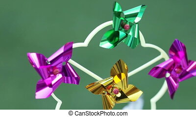Weathervane children - Rotating colorful pinwheels on a...