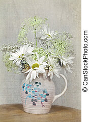 Still Life - Butterfly on a daisy bouquet in textured...