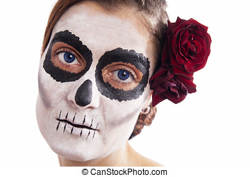 Woman with makeup of la Santa Muerte with red rose in front...