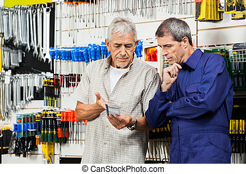 Customer And Vender Discussing Over Packed Tool - Senior...