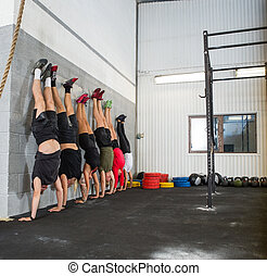 People Doing Handstands At Cross Training Box - Full length...