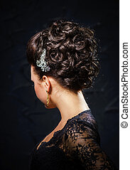 Beautiful bride with fashion wedding hair-style, studio...