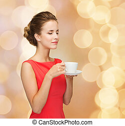 smiling woman in red dress with cup of coffee - leisure,...