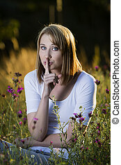 Woman showing quiet sign