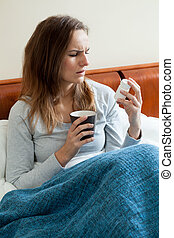 Sick woman resting in bed - View of sick woman resting in...