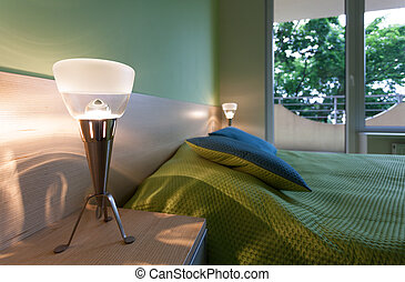 Green bedroom with modern lamps
