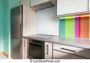 Colourfull modern kitchen with decorative wall