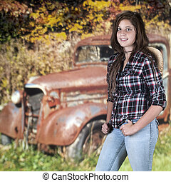 Happy Teen and a Junk Truck - A beautiful young teen...