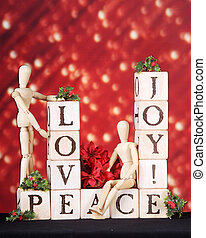 Christmas Wishes - Love, joy and Peace spelled out in rustic...