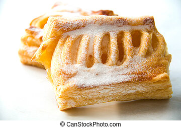 apple puff pastry and filling insied on white - A apple puff...
