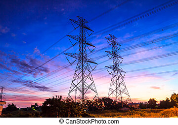 electricity high voltage power pylon at dusk