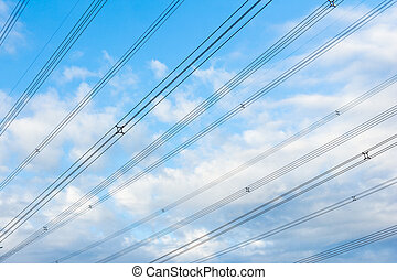 high power voltage cable line against blue sky