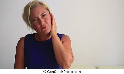 Ear pain - Woman having ear ache