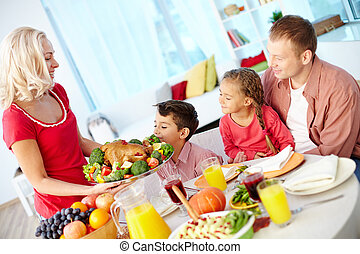 Festivity - Portrait of man and two kids looking at roasted...